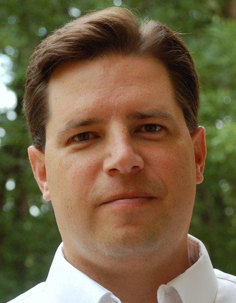J. Ed Komoszewski